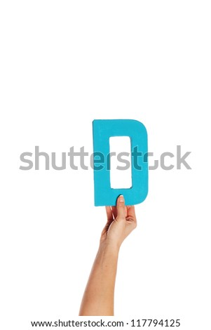 Female hand holding up the uppercase capital letter D isolated against a white background conceptual of the alphabet, writing, literature and typeface - stock photo