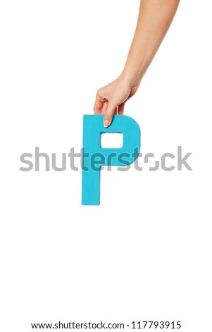 Female hand holding up the uppercase capital letter P isolated against a white background conceptual of the alphabet, writing, literature and typeface - stock photo
