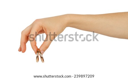 Female hand holding wedding rings isolated on white background