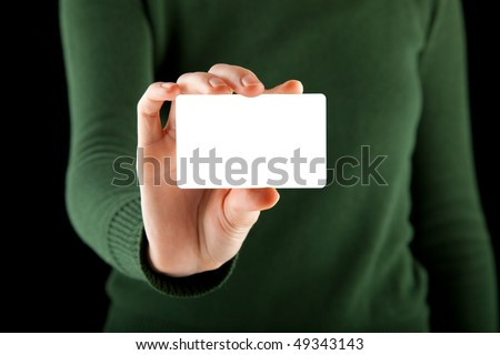 female hand holds a blank card - a business card, a gift card, or even a credit card - just to name a few different options - stock photo