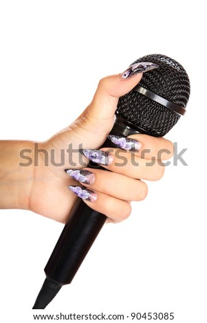 female hand holds  microphone on a white background - stock photo