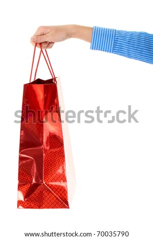 female hand holds red gift bag, isolated on white