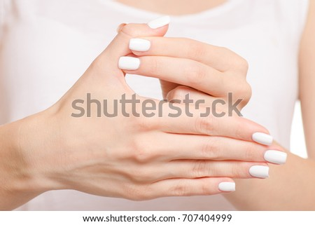 Female hand hurts a finger fracture of a dislocation on a white background isolation