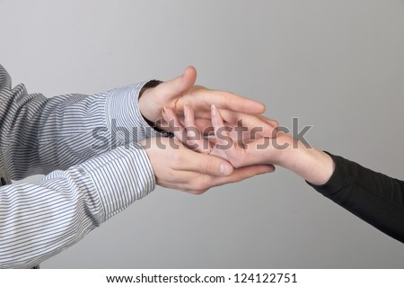 Female hand in a man's hand - stock photo