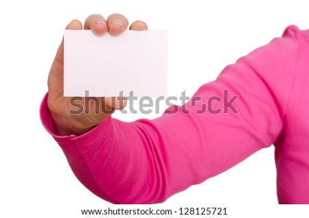 Female hand in magenta pullover is holding a blank business card - stock photo