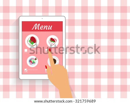 Female hand is ordering food in the restaurant via mobile app displayed on tablet pc. - stock photo