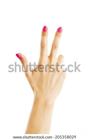 Female hand is showing three fingers. Isolated on white background  - stock photo