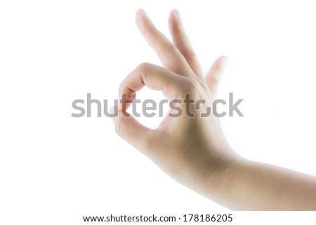 Female hand making OK gesture isolate on white background - stock photo
