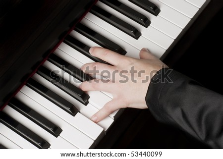 Female hand on a piano