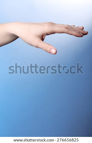 Female hand on colorful background