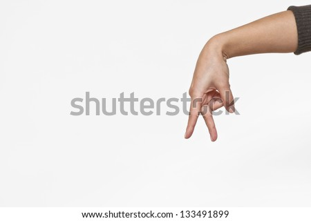 Female hand on the isolated background. Walking sign - stock photo