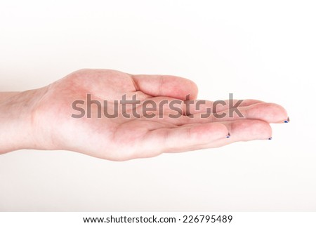 Female hand on white in a gesture of holding something, giving, or taking - stock photo