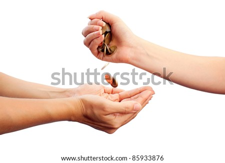 Female hand pour down coins into hands of another person. With clipping path - stock photo