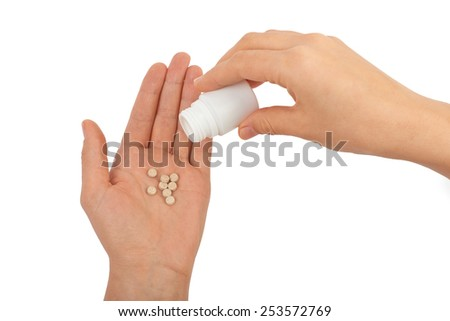 Female hand pouring pills (pure white background) - stock photo