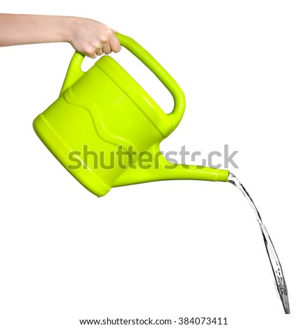 Female hand pouring water from green plastic watering can, isolated on white - stock photo