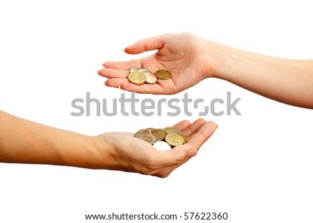Female hand pours down coins into hand of another person, isolated on white background - stock photo