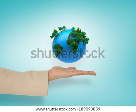 Female hand presenting blue earth against blue vignette