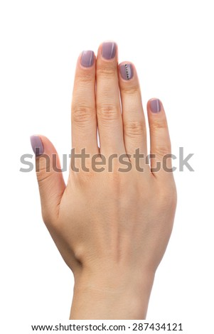 Female hand, purple manicure with rhinestones. Isolate on white. - stock photo