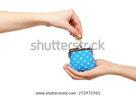 Female hand putting coin into purse isolated on white - stock photo