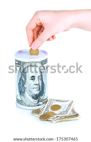 Female hand putting money in moneybox isolated on white