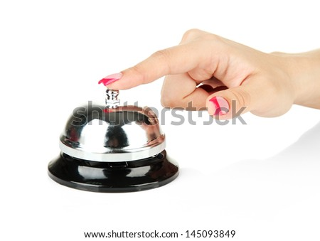 Female hand ringing in service bell isolated on white