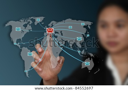 female hand send electronic mail to the world from EU (Map from Nasa) - stock photo