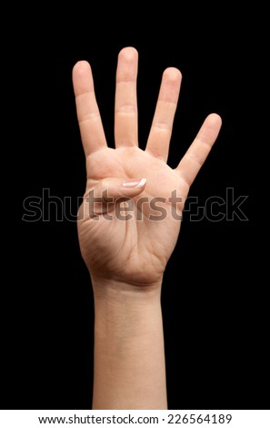 Female hand showing number four on a black background - stock photo
