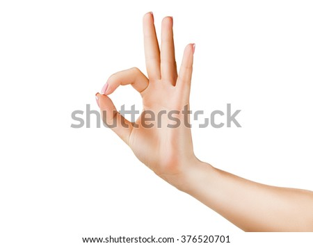 Female hand showing OK sign isolated on white background