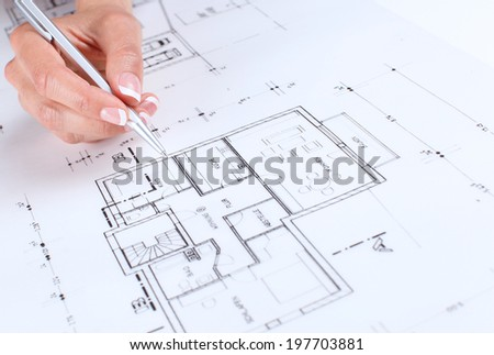 female hand showing on sketches - stock photo