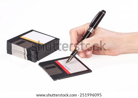 female hand signs floppy disk over white background - stock photo