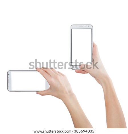 Female hand taking photo with smart phone of blank white touch screen, front view, isolated. Mockup for design - stock photo
