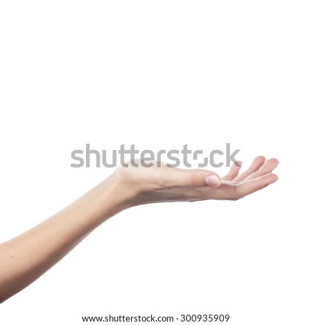 Female hand to create a collage, isolated on white - stock photo