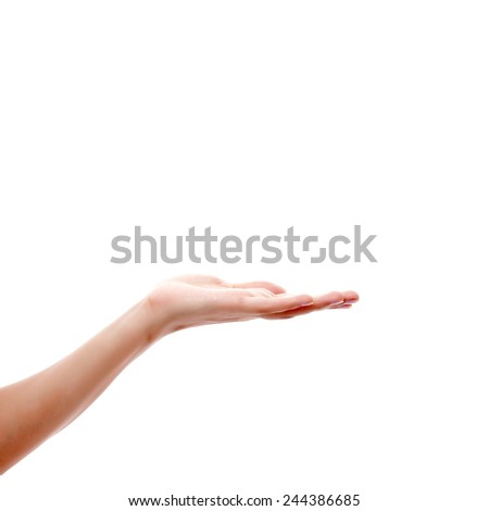 Female hand to create collages with objects on the palm - stock photo