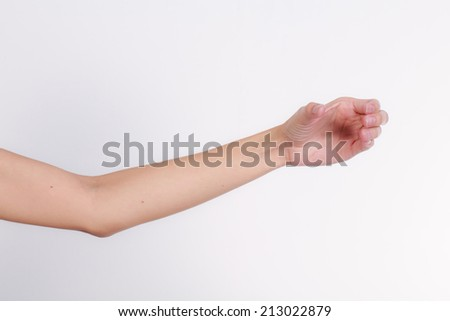female hand to hold gadget, isolated on white - stock photo