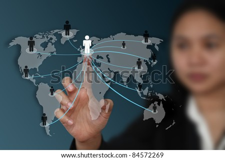 female hand touch on screen for social network concept (Map From NASA) - stock photo