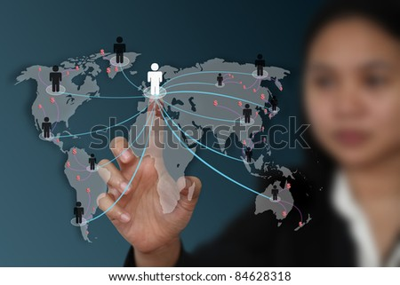 female hand touch on screen for social network marketing concept (selective focus on hand) - stock photo