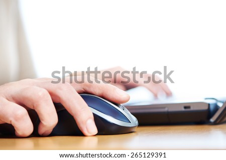 Female hand touching computer mouse closeup - stock photo