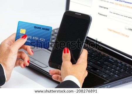 Female hand,using internet card for e-banking.