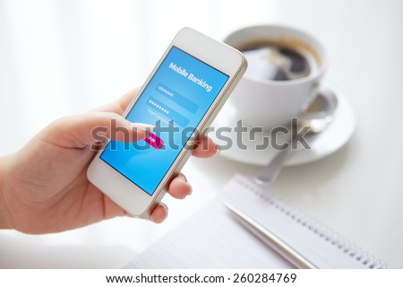 Female hand using mobile banking on white smartphone - stock photo