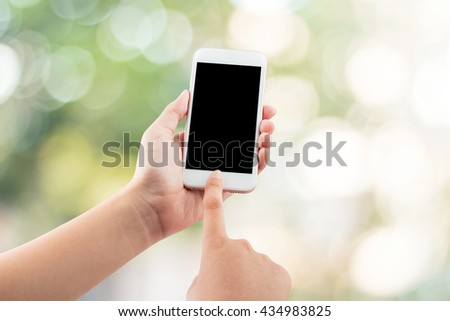 Female hand using mobile smartphone blurred background - mockup template, clipping path