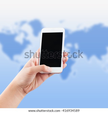 female hand using phone world map background, clipping path - stock photo