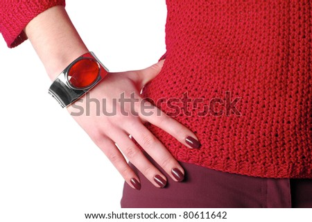 female hand wearing bangle touching the waist