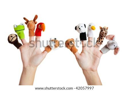 Female hand wearing 10 finger puppets; monkey, frog, reindeer, parrot; lion; bear; panda; duck; giraffe; elephant - stock photo