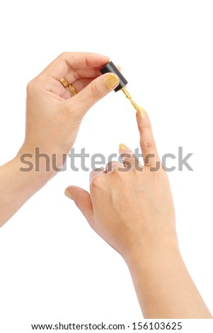 female hand with a golden nail polish on white background (with clipping path) - stock photo