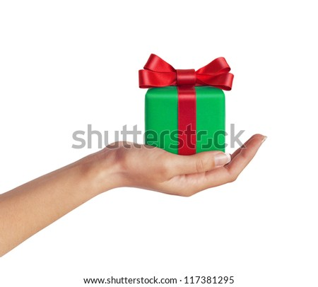 Female hand with a green gift with a red ribbon isolated on white background