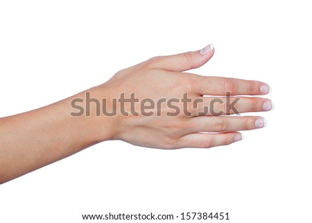 Female hand with beautiful nails extended to greet isolated on a white background - stock photo