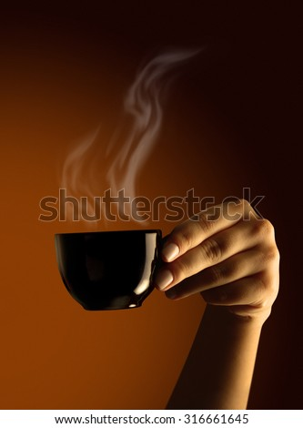 Female hand with cup of coffee - stock photo