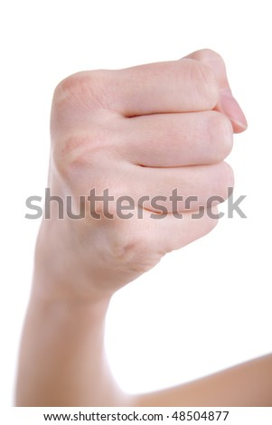 Female hand with fist against a white background, shallow DOF