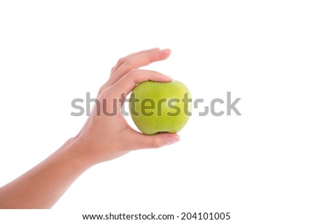 Female hand with green apple - stock photo