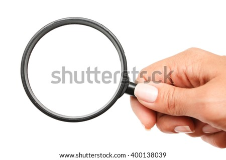 Female hand with magnifying glass.  - stock photo